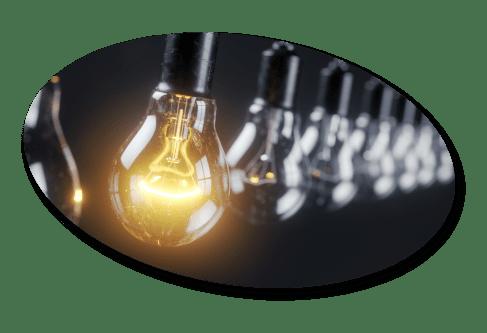 Single glowing lightbulb in a row of lightbulbs